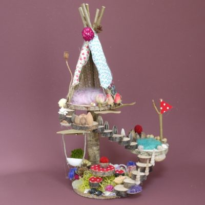 Naturemake model of their Mini Teepee Fairyhouse kit