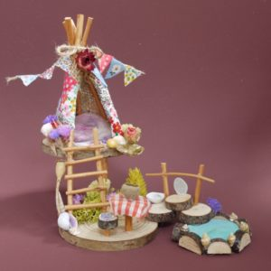Naturemake model of their Mini Fairy Teepee kit
